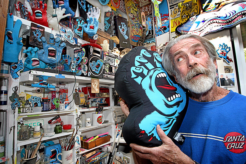 Santa Cruz artist and illustrator Jim Phillips listens for the sound of one hand screaming in his studio. Phillips created the screaming hand 30 years ago and The Santa Cruz Museum of Art & History celebrates the 30th anniversary Friday with a show of art by Phillips and 200 international artists influenced by this icon of youth skate culture.  (Dan Coyro -- Santa Cruz Sentinel)